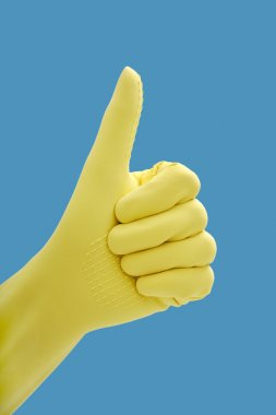 Hand in rubber gloves gesturing okay, close up stock vector