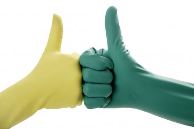 Two hands in rubber gloves gesturing OK