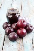 Photo open jar of plum jam