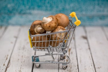 shopping cart with mushrooms