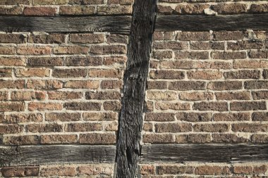 wall with bricks and wooden beam