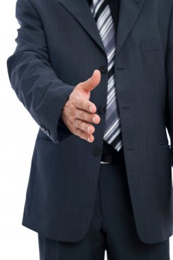 Businessman with hand outstretched for shakehands