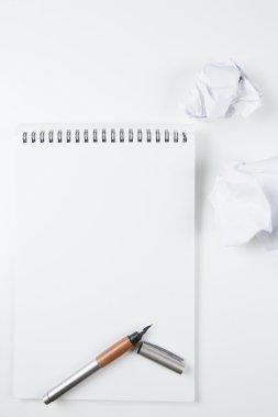 Fountain pen on notepad
