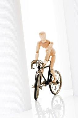 Wooden figurine riding racing bike