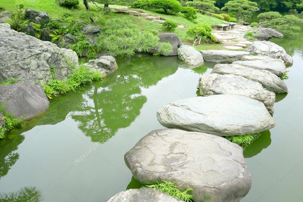 stone bridge and water pond in japanese zen garden stock photo 113776410 - Japanese Garden Stone Bridge