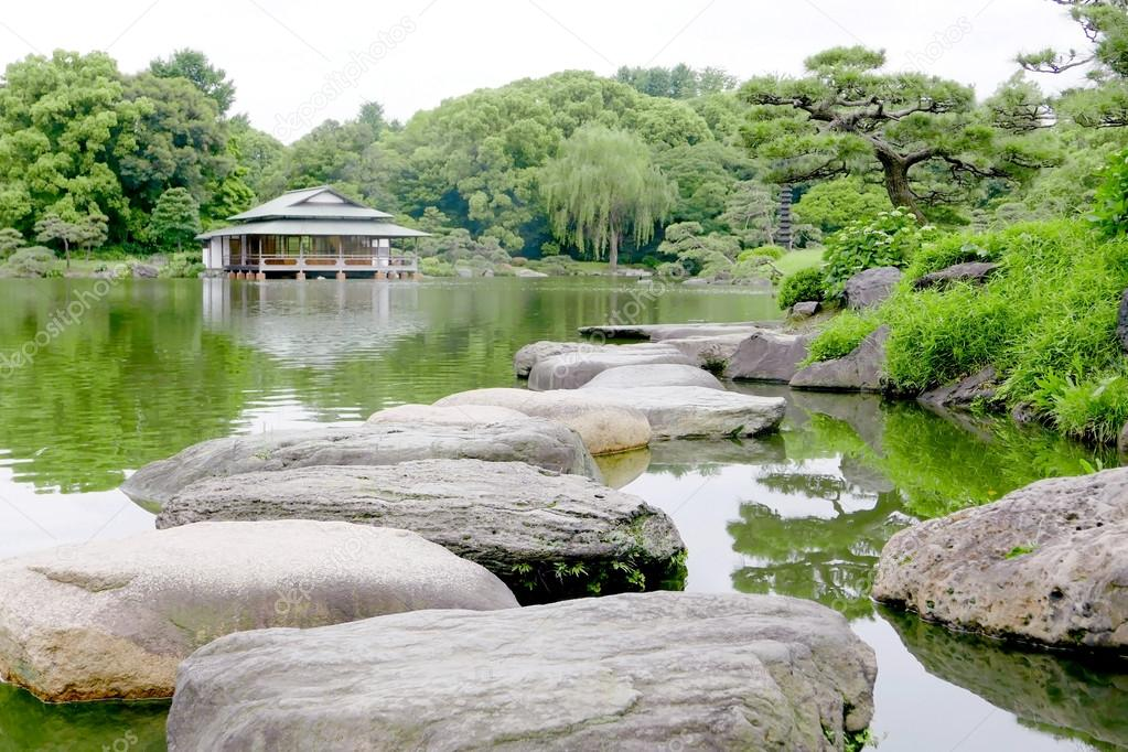 japanese pavilion building stone bridgewater pond in the zen garden photo by cougarsan - Japanese Garden Stone Bridge