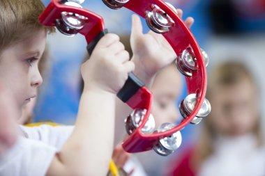 Boy Playing Tambourine at Nursery