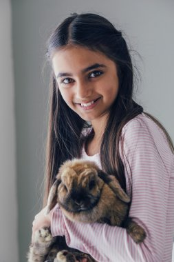 girl with her pet rabbit.