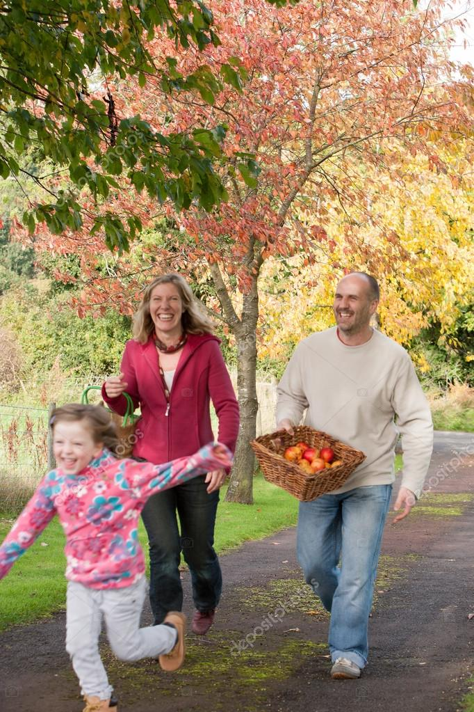 Parents walking outdoors with children