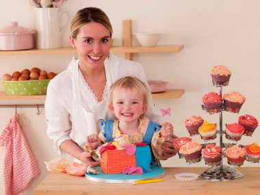 Mother and Daughter decorating cakes together