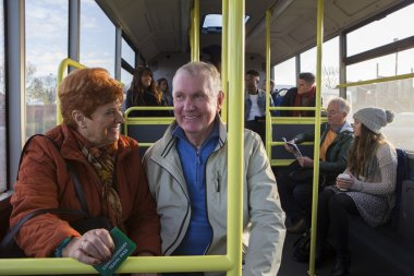 Senior couple on a bus