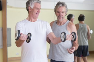 Men using weights together