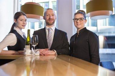 Bar staff posing at work