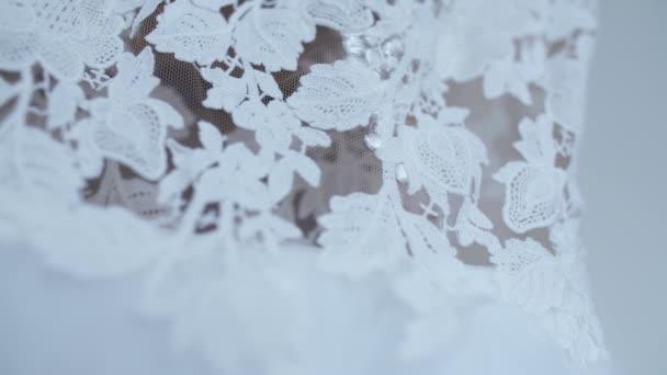Beautiful white wedding dress detail.