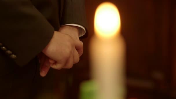 Rack focus on lit candles