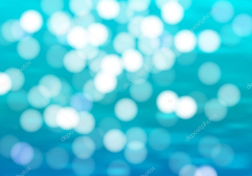 Blue water background with bokeh.