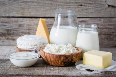 Selection of dairy products on rustic wood bacground