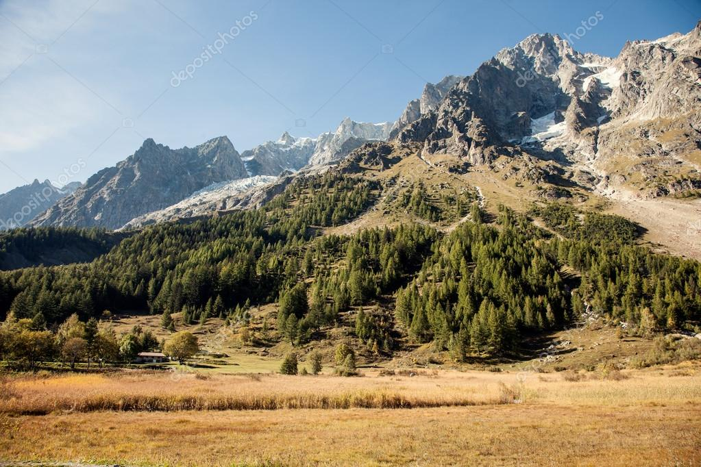 Italian summer. Mountain peaks and meadows near Courmayeur, Val d'Aosta province,Italy