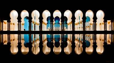 Water reflections of Zayed mosque columns, Abu Dhabi, United Arab Emirates