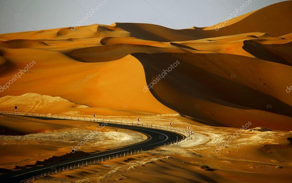 Winding road and sand dunes in Liwa oasis, United Arab Emirates