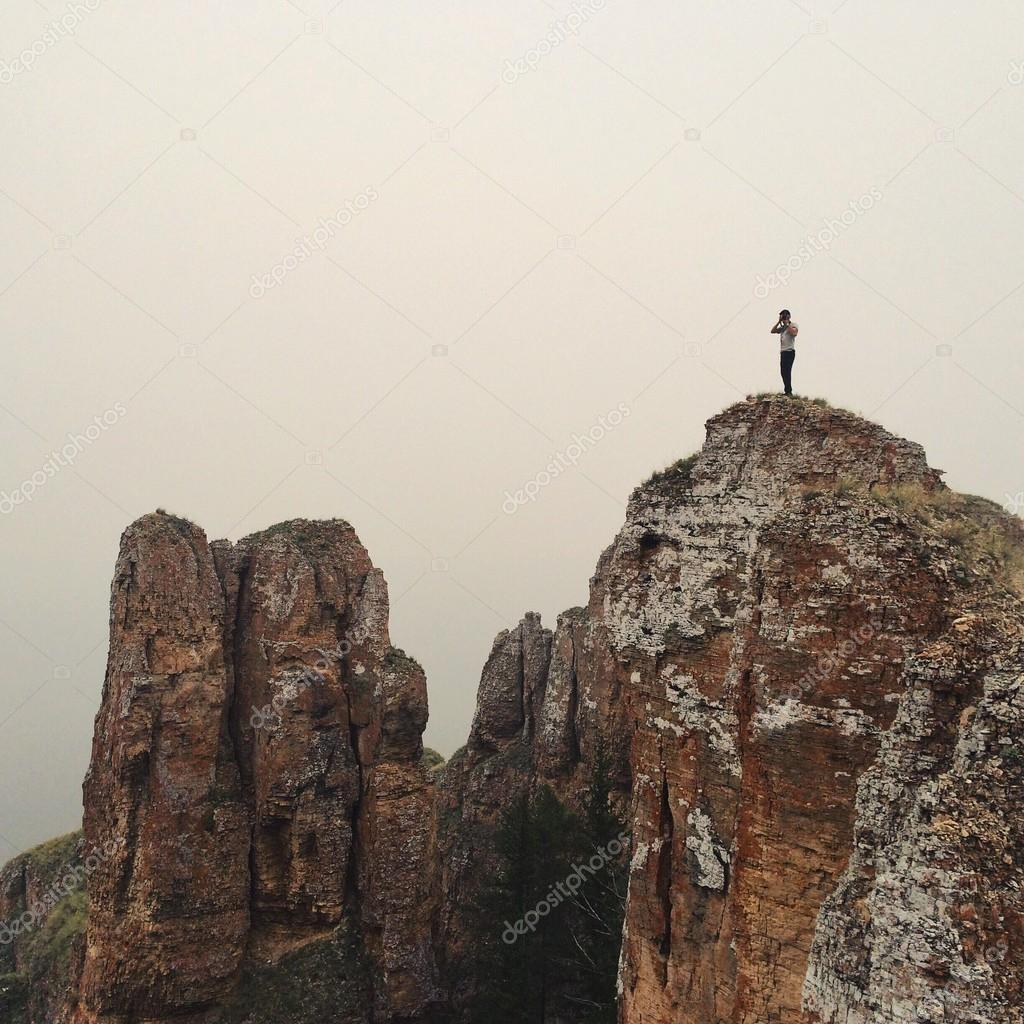 Photographer on top of mountain