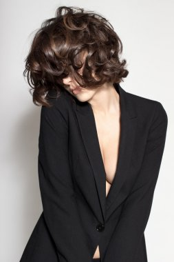 Portrait of gorgeous young caucasian attractive sexy business woman or secretary wearing black jacket and glasses