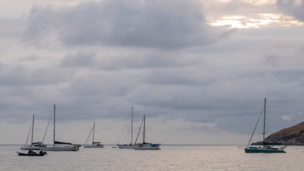 Timelapse of Clouds over sea with Yacht boat sailing boats or Travel boats in open sea at sunset sky Amazing for summer holiday background and Travel destination or Website