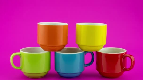 Stop motion animation of colorful coffee cup on colorful background A lot of cups for coffee and tea in coffee shop Video footage stop motion timelapse Seamless loop video Time Lapse Food and drink
