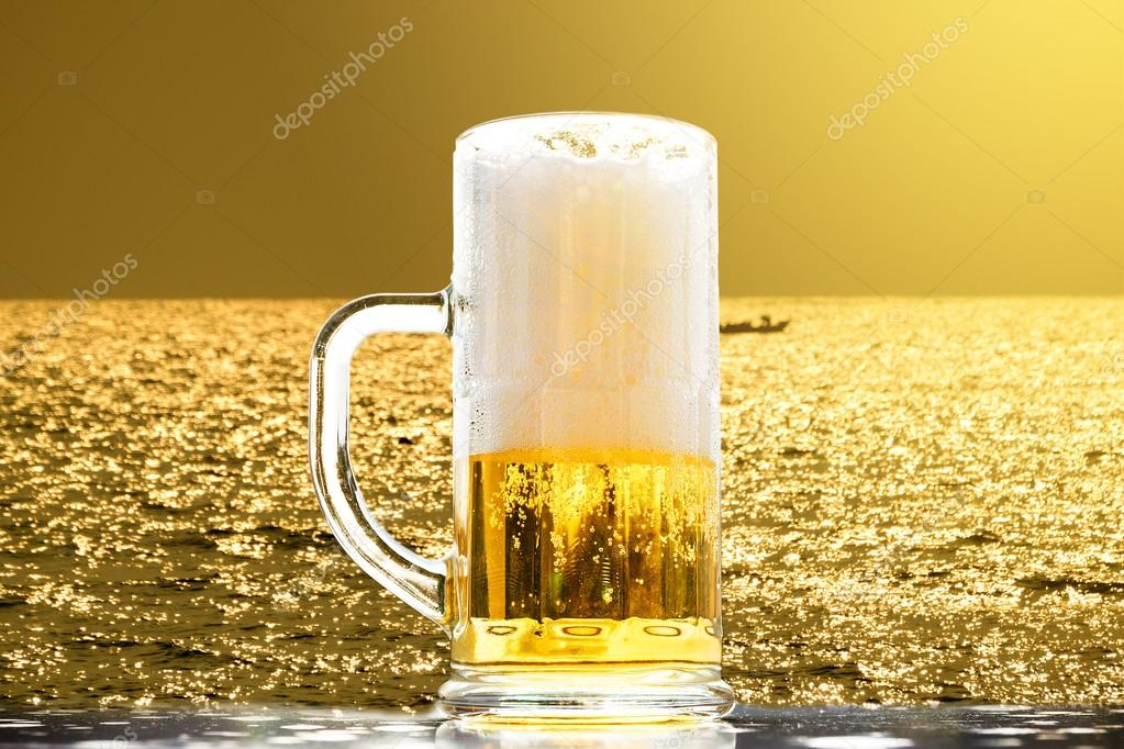 Beer golden white bubbles.