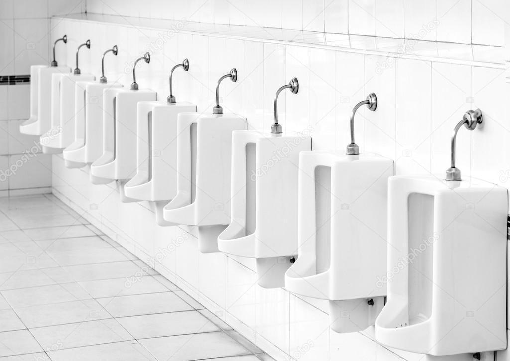 Design Of White Ceramic Urinals For Men In Public Toilet Room. U2014 Photo By  Etaphop