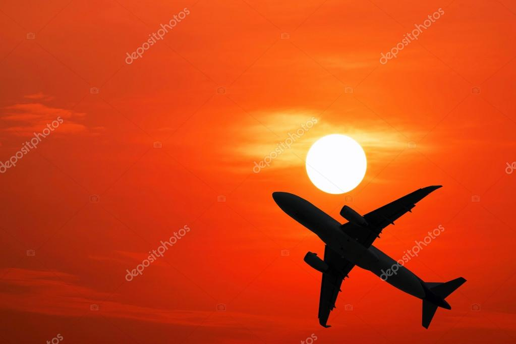 Silhouette airplane and the red sky