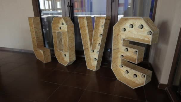 average plan decorations with the words love. Panorama camera moves from left