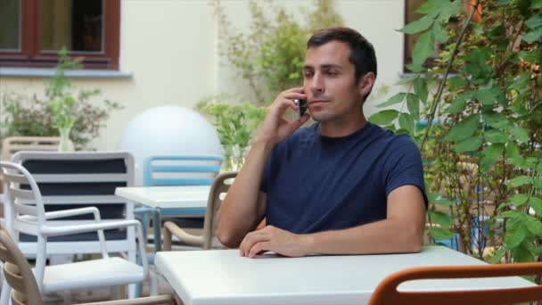 man 29-30 years of talking on the phone in white, Iphone