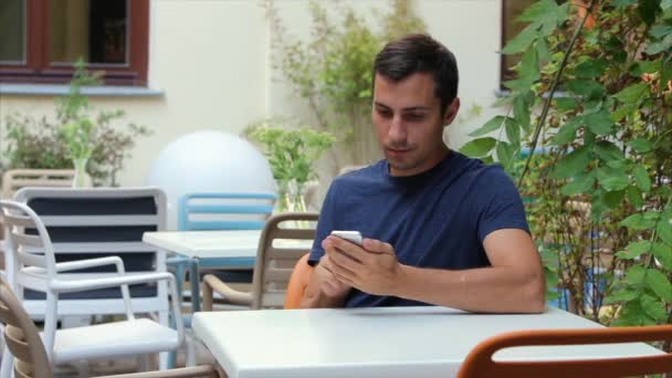 man 29-30 years Turns the page the browser on the phone in white, Iphone