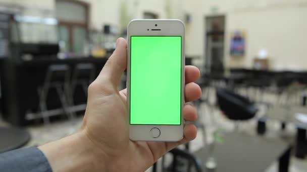 A Cafe W-különböző zöld képernyő kézmozdulatok, függőleges szúró telefon.