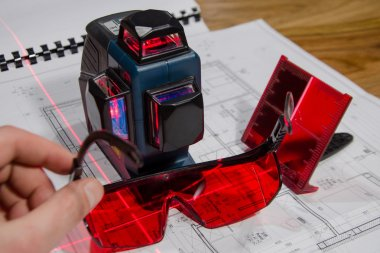 laser cross with red glasses