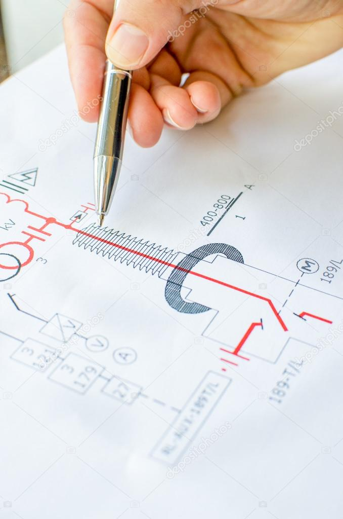 hand pen indicating electrical scheme - electrical engineering ...