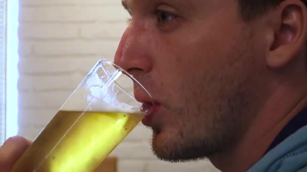 Stock video footage restaurant man drinks beer