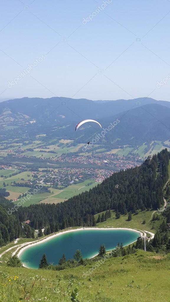 Paragliding in mountains with lake