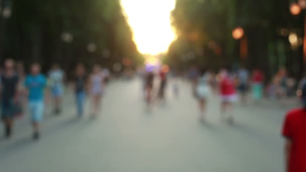 People walking through the summer park blurry fast mode