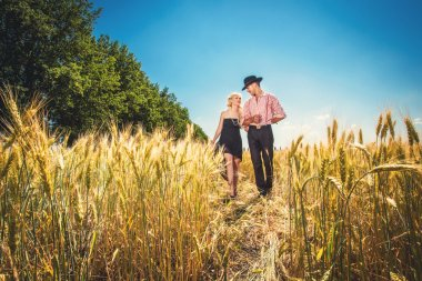 Couple going through the field