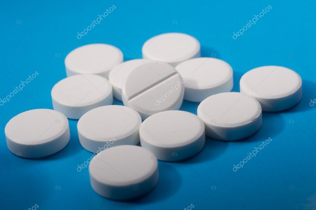 White Round Pills On Blue Background Stock Photo Man 81511480