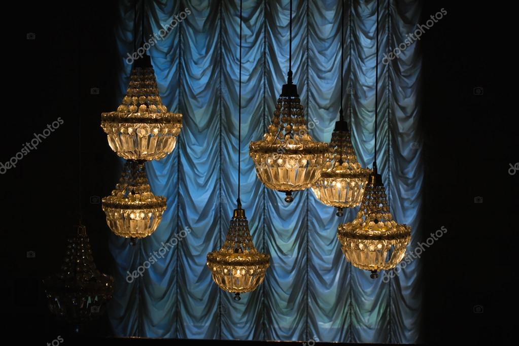 Yellow Chandeliers Hanging Next To Blue Curtain In A Dark Hall Photo By M N