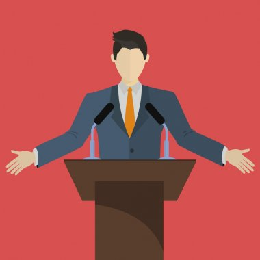 Speaker speaking on a stage with microphones