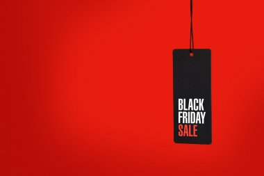 Black friday. Sale tag on red background