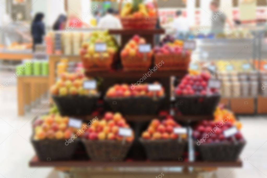 Selling fruit on the counter, pile of apples and other fruits , retail and wholesale, blurred