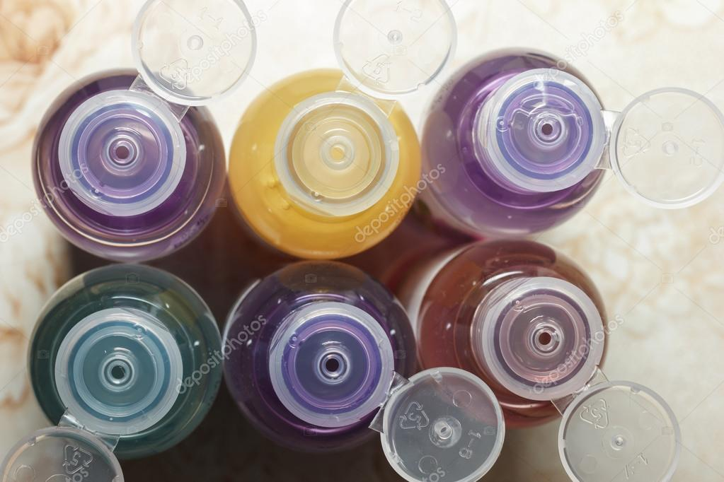 Colored bottles for cosmetics, cosmetics and shampoos, top view