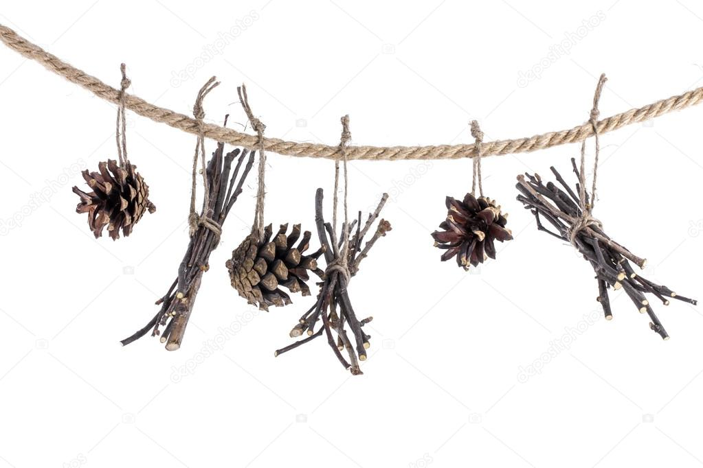garland of cones and twigs on a string on a white background