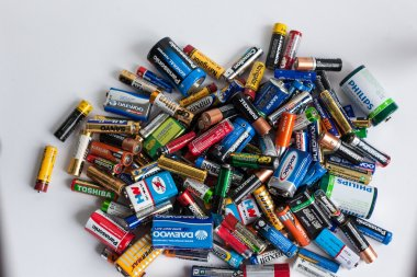 Color batteries of different sizes on a white background isolate