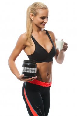 Athletic beautiful smiling blonde woman with proteine and glass of milk, sporty lifestyle, sports nutrition. Isolated.